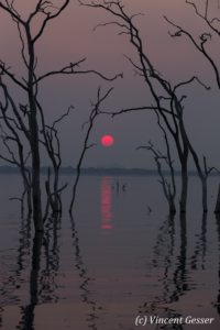 Sun setting over the quiet waters of Lake Kariba, Zimbabwe, 4