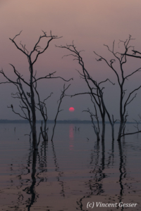Sun setting over the quiet waters of Lake Kariba, Zimbabwe, 5