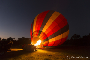 Aerial view and photography, hot air balloon preparation, Masai Mara National Reserve at dawn, TransMara, Kenya